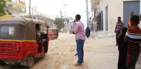 Youth activist Ahmed Aden Hashi spreads information on COVID-19 in Mogadishu by utilizing a megaphone