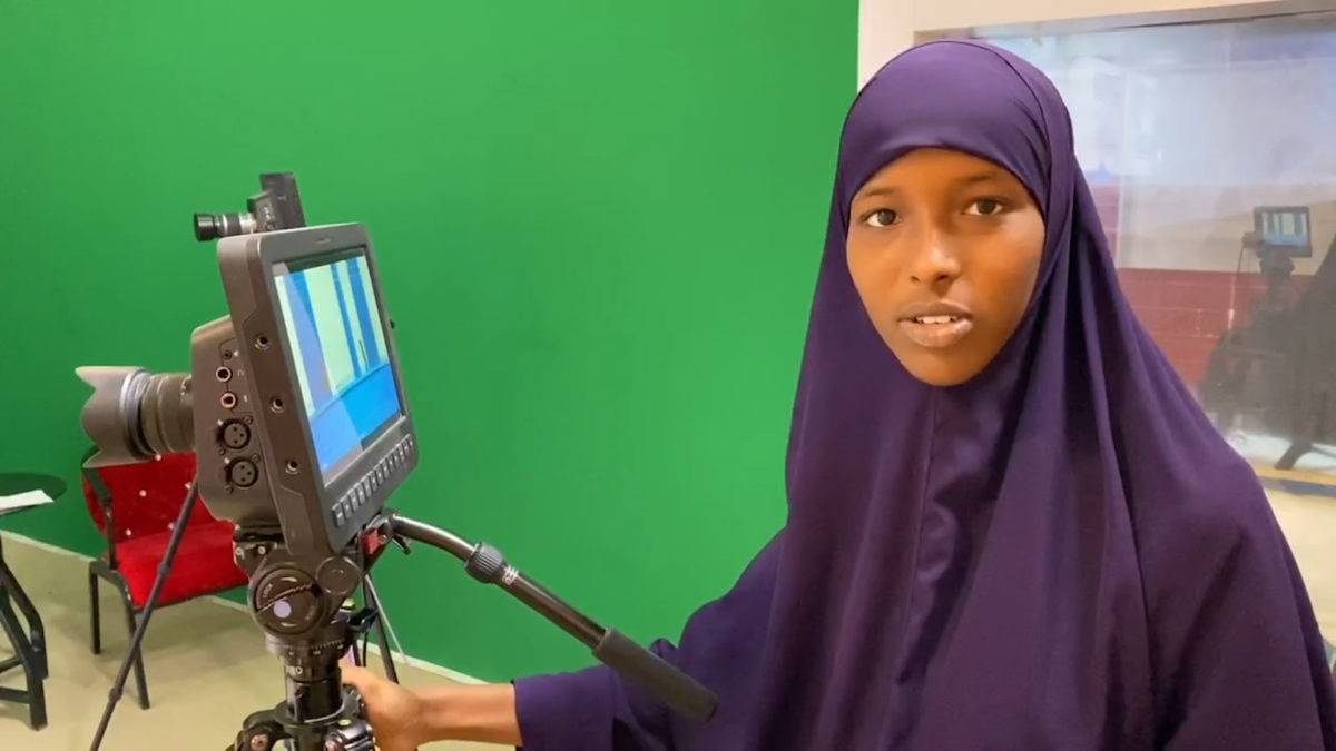 Somali National TV camerawoman Nastexo Abdi Jaliil at work. SNTV has supported the dissemination of the produced videos and studio discussion on COVID-19.